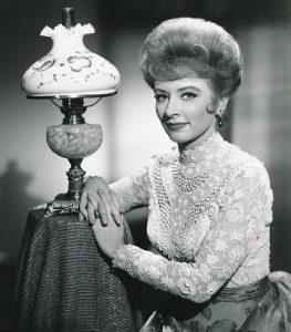 Amanda Blake as Miss Kitty in Gunsmoke